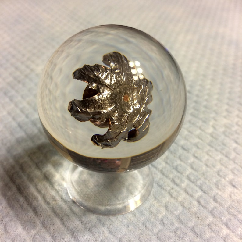 9mm Speer Gold Dot 124 Grain +P Fully Expanded Bullet - Encased In Resin  Sphere - Clear Acrylic Ring Stand Included