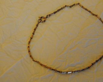 Silver colored bracelet or anklet