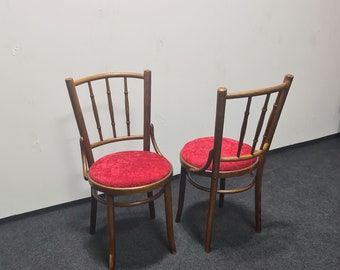 A pair of vintage bistro chairs