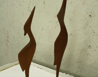 Two Vintage teak water bird ornaments