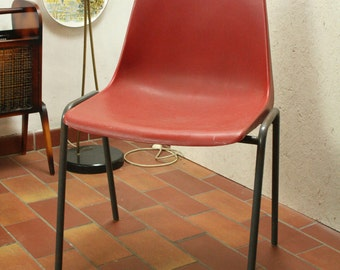vintage red molded plastic stacking chair by Kusch + Co