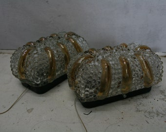 A pair of Vintage glass wall mounted lights