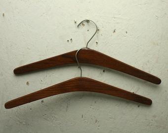 two vintage teak coat hangers