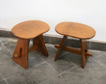 A pair of vintage oak stools