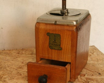 Vintage coffee grinder by Trosser .