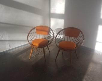 A pair of vintage Yngve Ekstron circle chairs