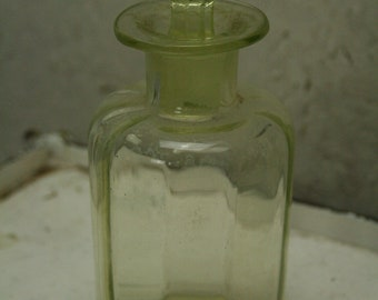 Vintage vaseline or uranium glass bottle with stop