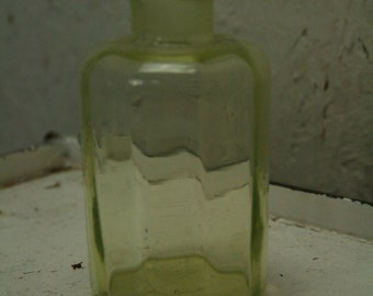 vintage vaseline glass bottle