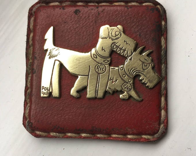 Ric et Rac brass and red leather badges Pol Rab French cartoon dogs circa 1920's