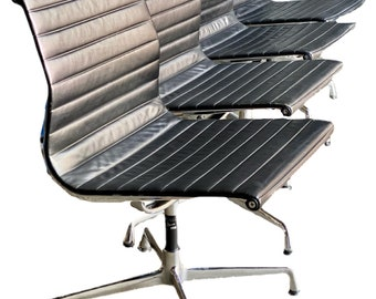 Eames Vitra EA 105 Alu group side chairs in chrome and black leather circa 1980's