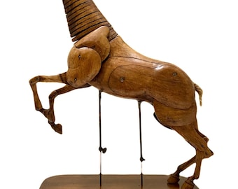 Early 20th century walnut and beech articulated horse lay figure.