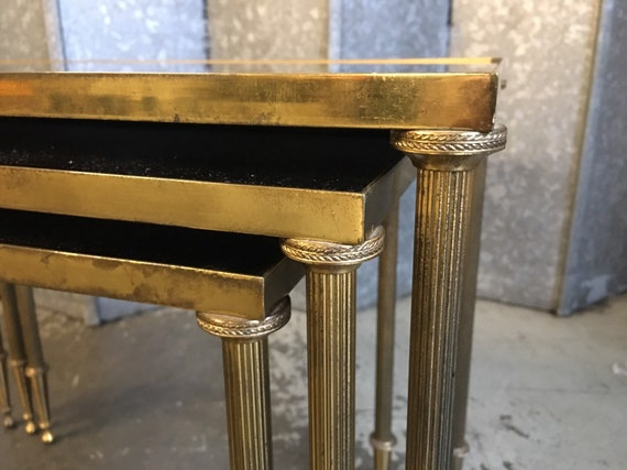 Vintage nest of three Maison Jansen style brass and mirrored top tables