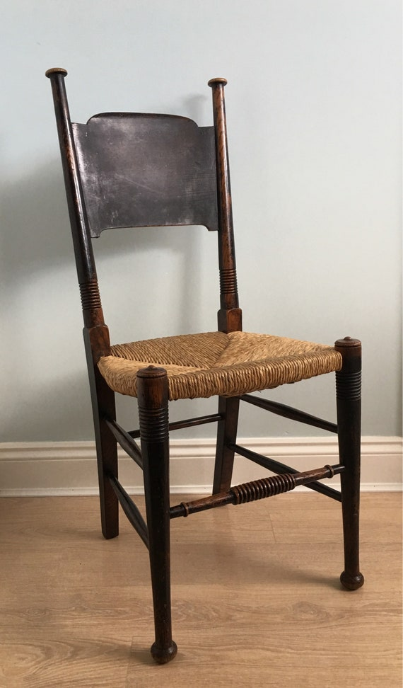 Arts and Crafts William Birch for Liberty & Co ebonised oak and rush seat sidechair circa 1905