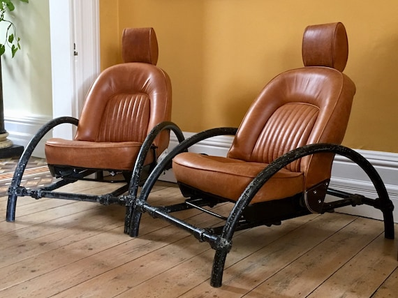 Pair of Ron Arad tan leather Rover chairs circa 1980's