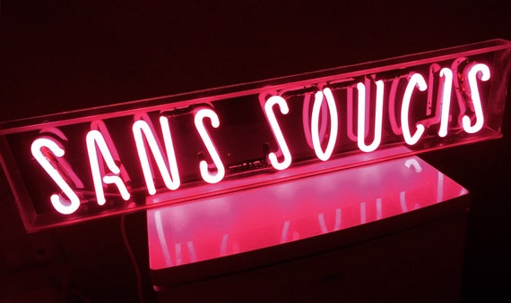 Vintage pink neon sign sans soucis from Holland