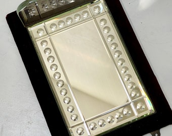 Late Victorian sorcerers mirror with glass shelf in red velvet frame