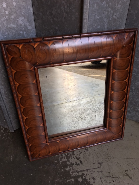 William and Mary style oyster veneered cushion framed mirror