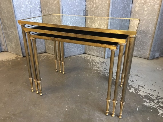 Vintage nest of three Maison Jensen brass and mirrored top tables