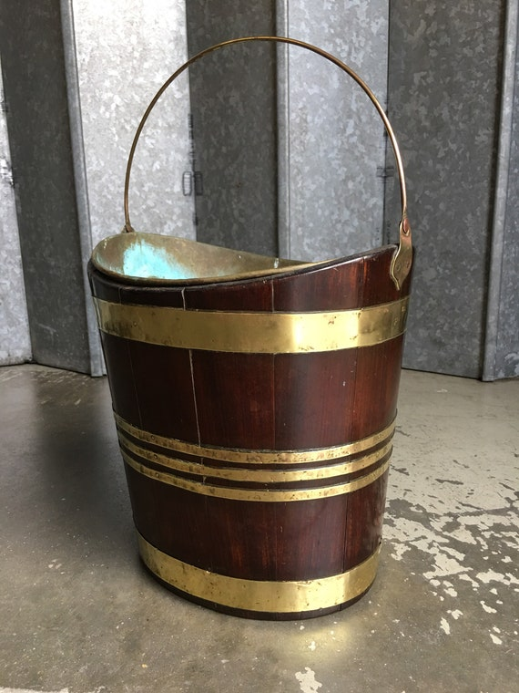Regency period traditional mahogany and brass peat bucket in navette form circa 1820