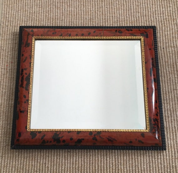 Late 19th century Dutch style tortoiseshell veneer and ebonised ripple framed bevelled mirror