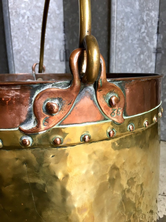 Mid English Victorian riveted copper and brass log bucket