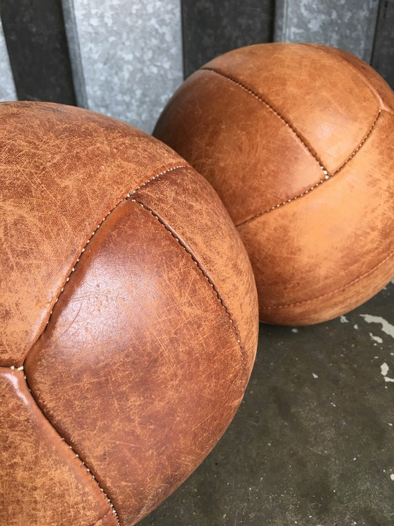 A pair of Mid 1970's leather medicine balls