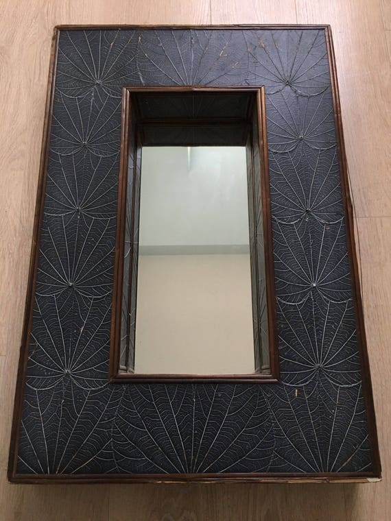 Vintage mirror with leaf skeleton decoration and bamboo cornice
