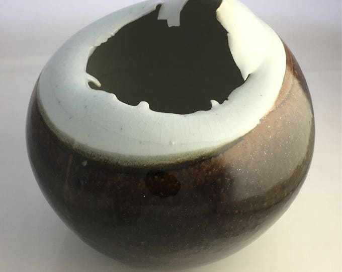 Vintage Porcelain ovoid collapsed form with tenmoku glaze