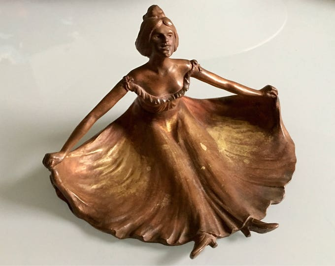Vintage Art Nouveau jugendstil style seated lady with outstretched skirt