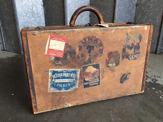 Early 20th century Edwardian Louis Vuitton leather and canvas luggage suitcase with Cunard label.