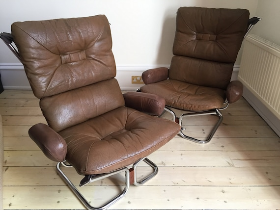A pair of Harald Relling Wing chairs for Westnofa of Norway in leather and chrome.