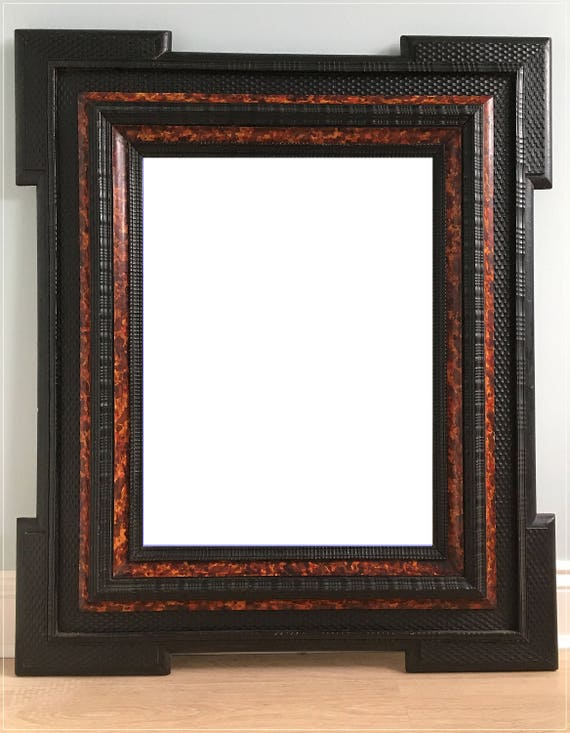 Late 19th century ebonised Dutch ripple frame faux tortoise shell mirror
