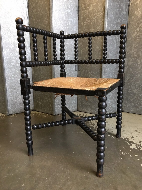 Arts and crafts late 19th century ebonised bobbin turned corner chair with original rush seat