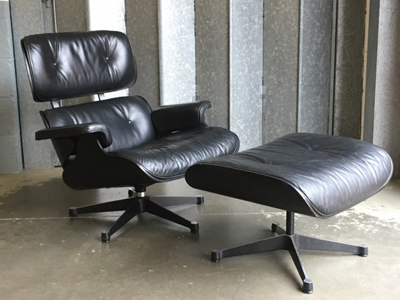 Charles and Ray Eames Vitra lounge chair and ottoman in black leather.