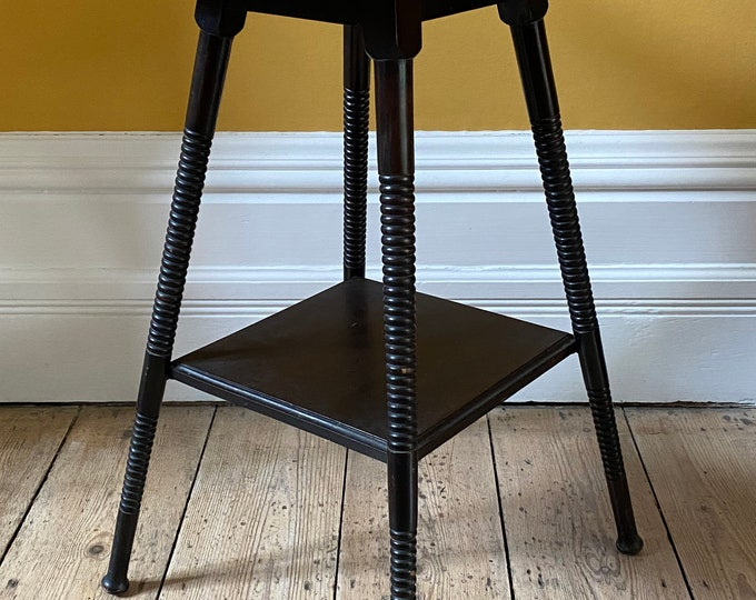 Arts and crafts William Birch ebonised two tier ring turned side table