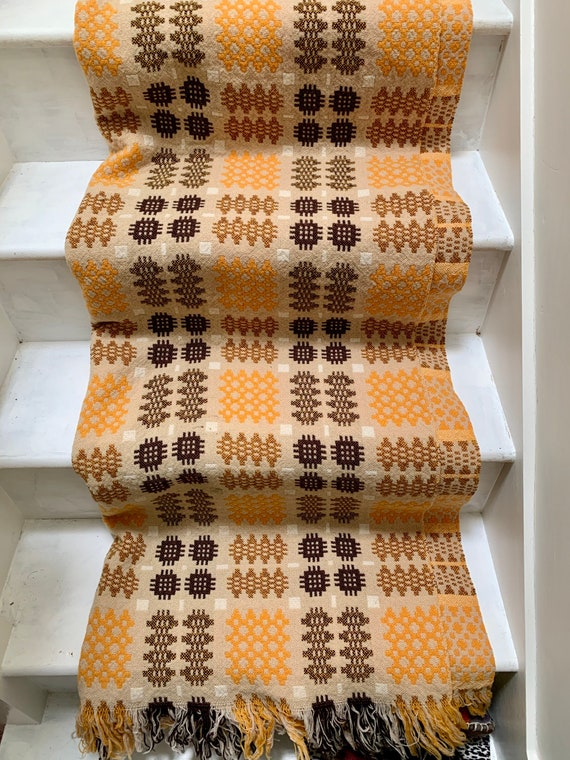 Vintage Welsh tapestry blanket in yellows, browns and creams.