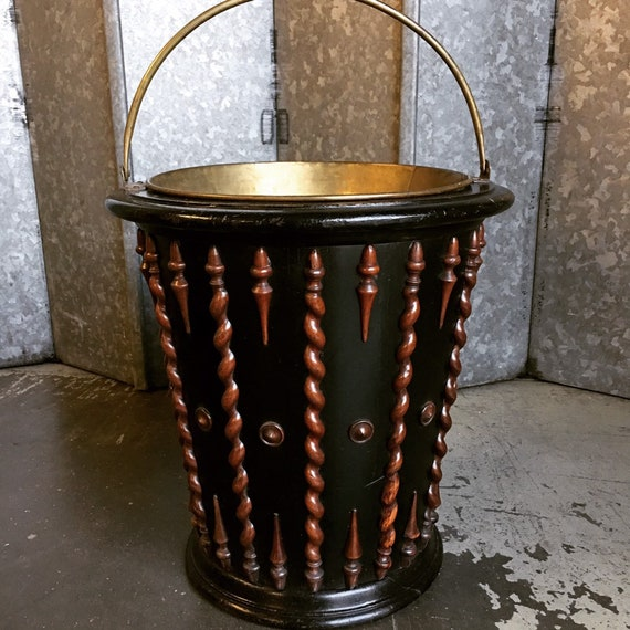 Antique Dutch peat bucket circa 1840's with spiral and acorn decoration on ebonised base