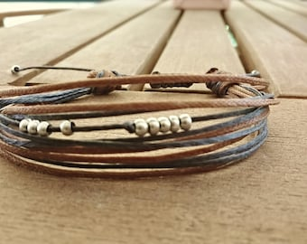 Beautiful Handmade Bracelet in Blue and Brown. Adjustable and Pretty bracelet for Everyone.