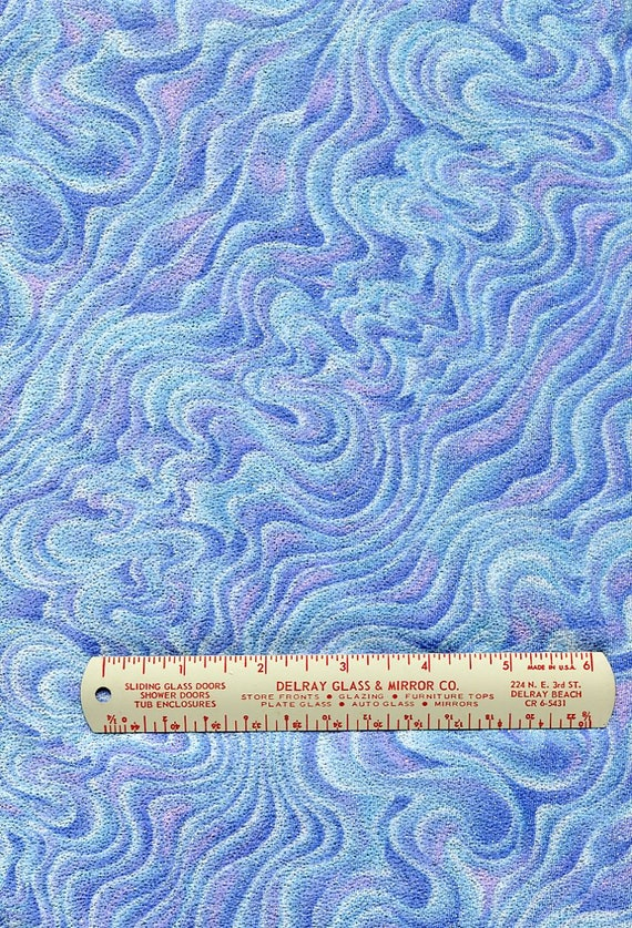 """Swirl Print Glitter Dance Wear, Poly/Lycra Marbled blues with lavender and white.  58/60"""" wide by 1.75 yards long"""