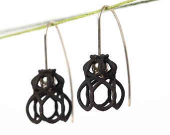 black dangle earrings made of sterling silver and 3D printed nylon a contemporary design jewelry