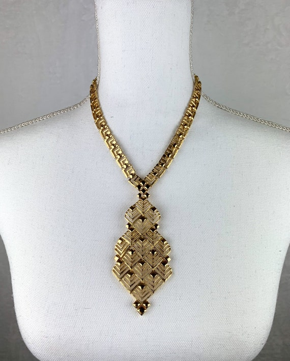 A96 Three strand choker with chains and decorative elements in gold tone metal Original 60s-70s Vintage necklace signed MONET cod