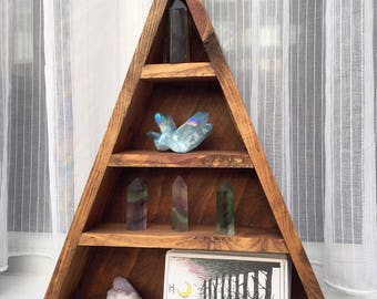Tall wooden shelf with back