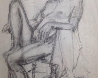 Model on wicker chair