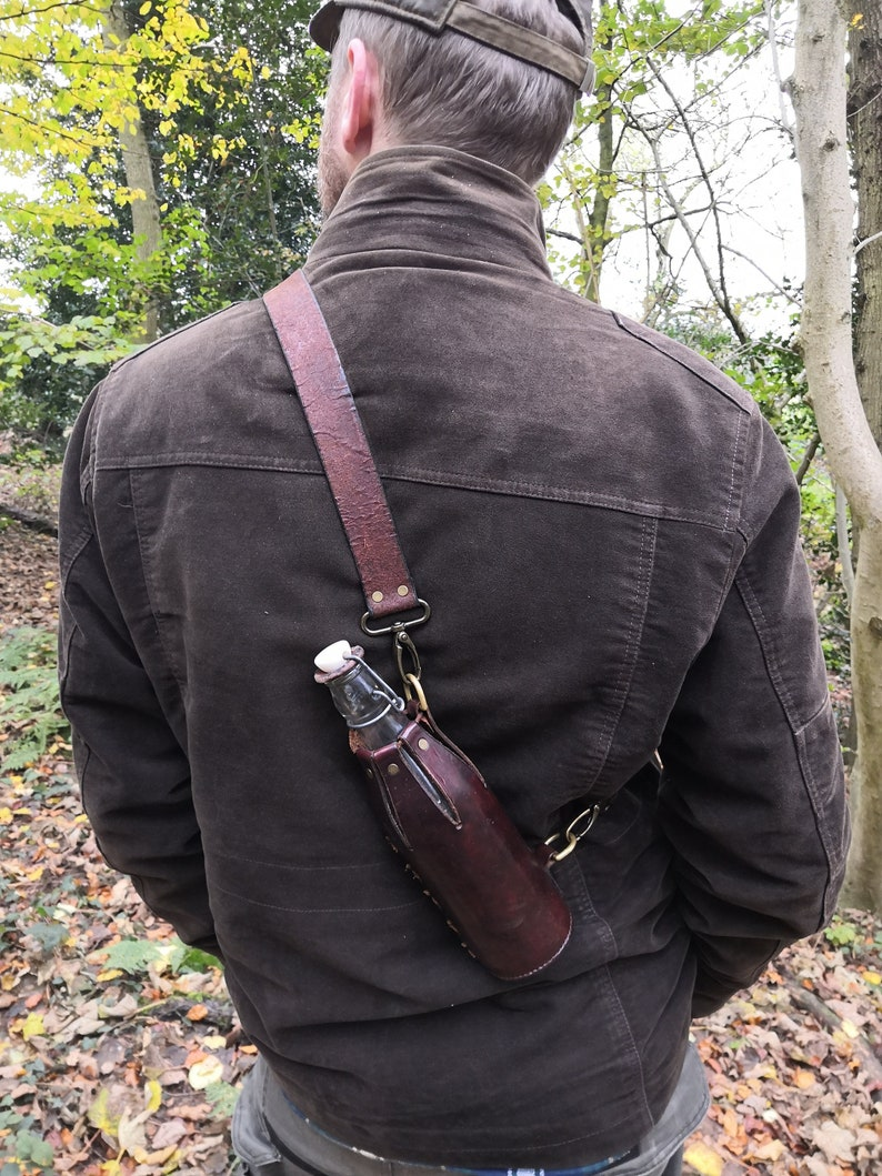 Water bottle with leather cover and optional shoulder strap image 0