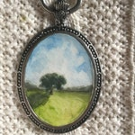 """Hand painted landscape pendant, with antique silver tone finish on 17"""" black rope"""