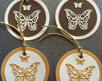 Four butterfly gift tags in neutrals and gold with gold cord