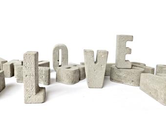 Gray small concrete letters. Industrial alphabet. Home decor