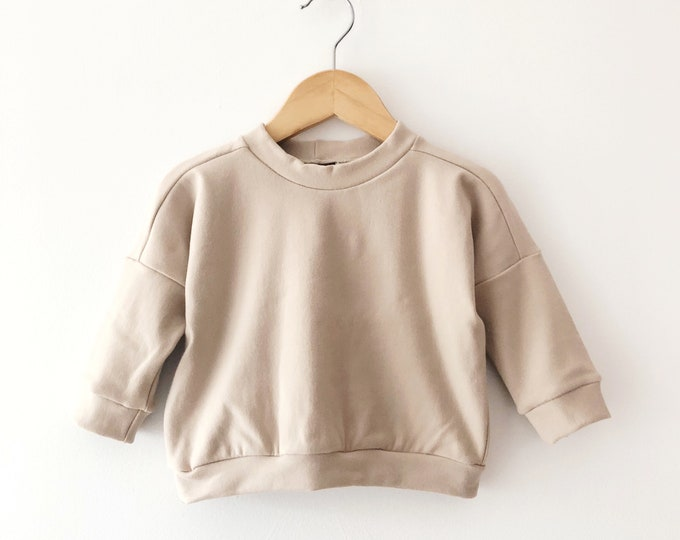 Nude drop sleeve sweater