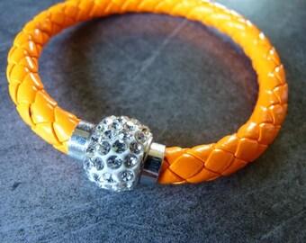 Orange braided leather strap and magnetic rhinestone ball