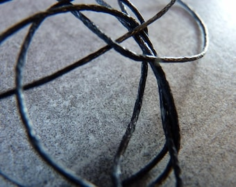 Thin cord in black cotton coated of 1 mm x 1 m